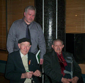 Ciaran Crossey photographed with Bob Doyle and Michael O'Riordan