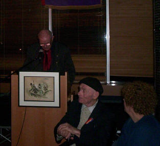 Michael O'Riordan observed by Bob Doyle, the man with the hat and the cane.